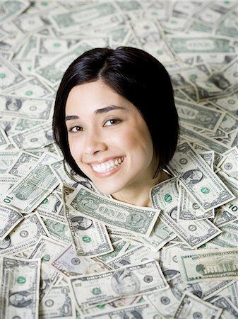 Head of woman emerging from dollar bills Stock Photo - Premium Royalty-Free, Code: 640-03265031