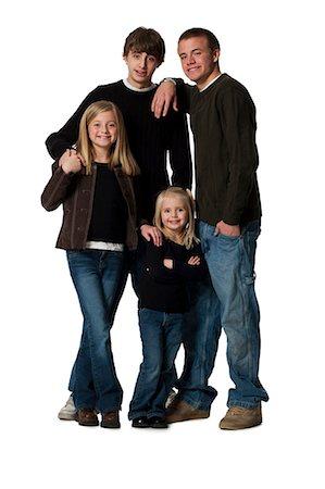 Family posing for portrait Stock Photo - Premium Royalty-Free, Code: 640-03265095