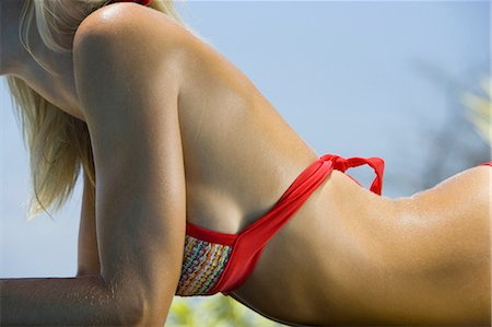 people having sex - Mid section view of a adult woman sunbathing Stock Photo - Premium Royalty-Free, Code: 640-03265647