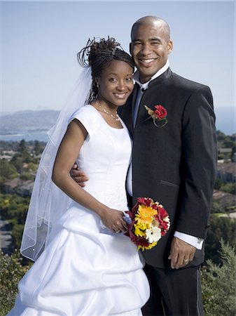 Portrait of a newlywed couple smiling together Stock Photo - Premium Royalty-Free, Code: 640-03265670