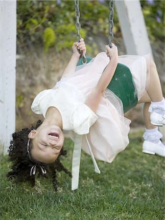 Close-up of a girl on a swing Stock Photo - Premium Royalty-Free, Code: 640-03265691