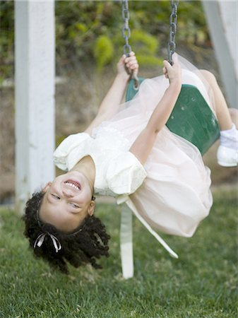 Close-up of a girl on a swing Stock Photo - Premium Royalty-Free, Code: 640-03265692