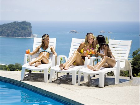 Three women relaxing on deck loungers Stock Photo - Premium Royalty-Free, Code: 640-03265700