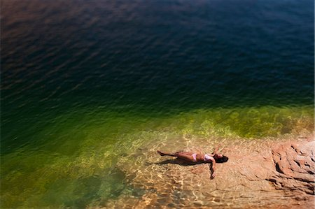 Woman lying in the water on back Stock Photo - Premium Royalty-Free, Code: 640-03260094