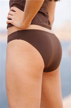 female rear end - Woman in brown swimsuit Stock Photo - Premium Royalty-Free, Code: 640-03260274