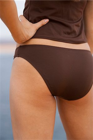 female rear end - Woman in brown swimsuit Stock Photo - Premium Royalty-Free, Code: 640-03260273