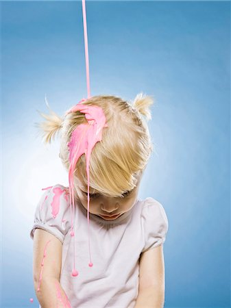 sad girls - little girl getting pink paint poured on her head Stock Photo - Premium Royalty-Free, Code: 640-03260381
