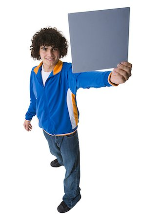 Man holding a blank sign Stock Photo - Premium Royalty-Free, Code: 640-03260733