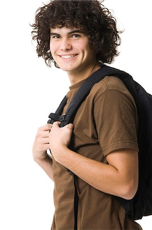 Teenage boy smiling with backpack Stock Photo - Premium Royalty-Free, Code: 640-03260748