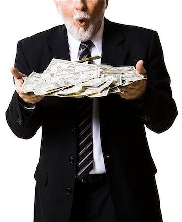 Portrait of businessman holding money bag Stock Photo - Premium Royalty-Free, Code: 640-03260968