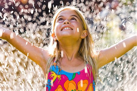 Girl in sprinkler Stock Photo - Premium Royalty-Free, Code: 640-03261026