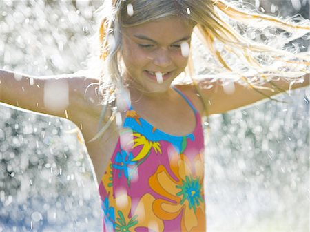 Girl in sprinkler Stock Photo - Premium Royalty-Free, Code: 640-03261022
