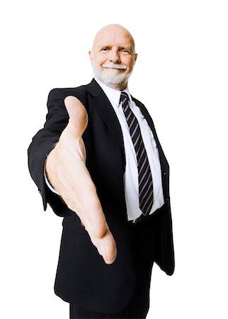 Portrait of businessman with outstretched hand Stock Photo - Premium Royalty-Free, Code: 640-03261079