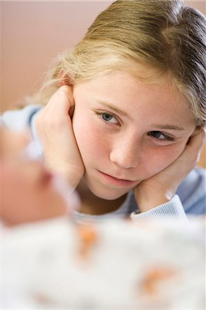 sad girls - Young girl sitting by brother in hospital bed Stock Photo - Premium Royalty-Free, Code: 640-03261659