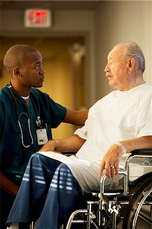 settlement - Mature man in wheelchair with doctor and nurse Stock Photo - Premium Royalty-Free, Code: 640-03261746