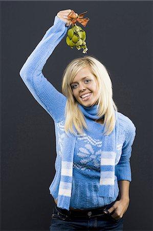 Woman holding mistletoe Stock Photo - Premium Royalty-Free, Code: 640-03262419