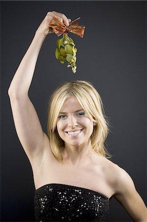 Woman holding mistletoe Stock Photo - Premium Royalty-Free, Code: 640-03262411
