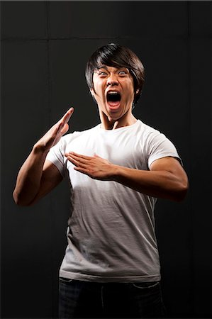 Muscular man with clenched fist shouting Stock Photo - Premium Royalty-Free, Code: 640-03262517