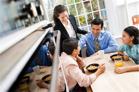 Family at breakfast table smiling Stock Photo - Premium Royalty-Free, Code: 640-03262662