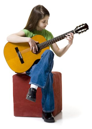 Girl playing the guitar Stock Photo - Premium Royalty-Free, Code: 640-03263382