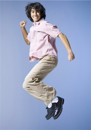 Boy jumping Stock Photo - Premium Royalty-Free, Code: 640-03263408