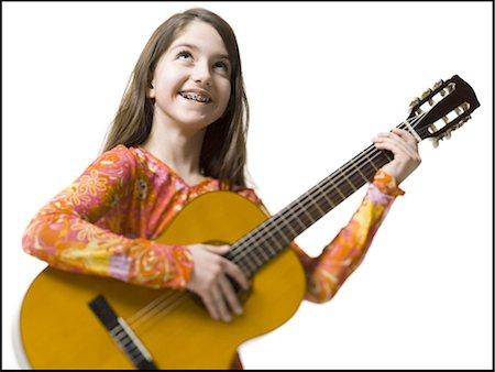 Girl playing the guitar Stock Photo - Premium Royalty-Free, Code: 640-03263400