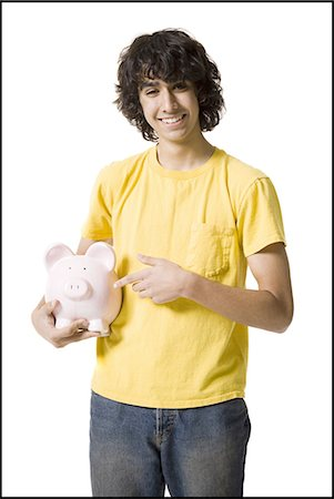 Boy holding a piggy bank Stock Photo - Premium Royalty-Free, Code: 640-03263425