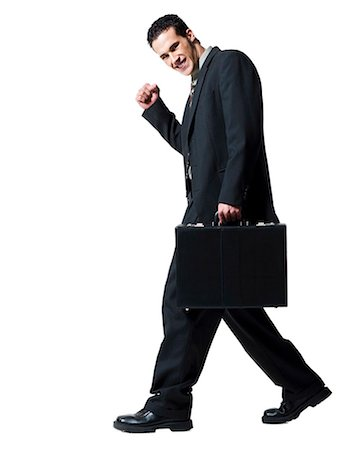 Businessman carrying a briefcase Stock Photo - Premium Royalty-Free, Code: 640-03263673
