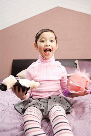 pantyhose kid - Portrait of a girl holding toys Stock Photo - Premium Royalty-Free, Code: 642-01735285