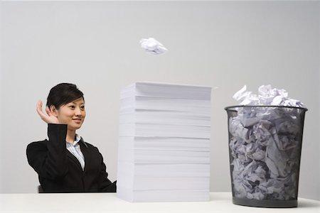 Business woman throwing paper to garbage bin Stock Photo - Premium Royalty-Free, Code: 642-01736461