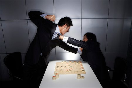 enemy - Two fighting young men and Chinese chess Stock Photo - Premium Royalty-Free, Code: 642-01737144