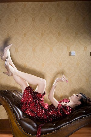 one fashionable woman lying and darting Stock Photo - Premium Royalty-Free, Code: 642-02004952