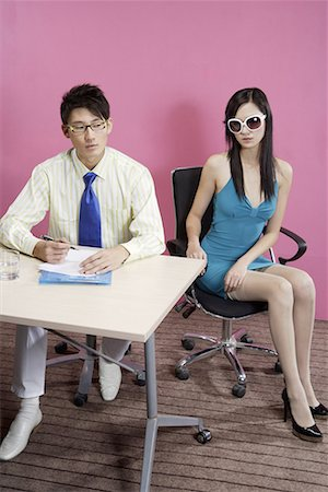 a business man and a fashionable woman Stock Photo - Premium Royalty-Free, Code: 642-02005911