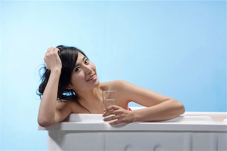 a fashionable woman taking a bath Stock Photo - Premium Royalty-Free, Code: 642-02005931