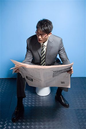 a reading busines man Stock Photo - Premium Royalty-Free, Code: 642-02005994