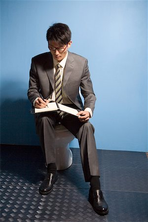 a reading busines man Stock Photo - Premium Royalty-Free, Code: 642-02005995