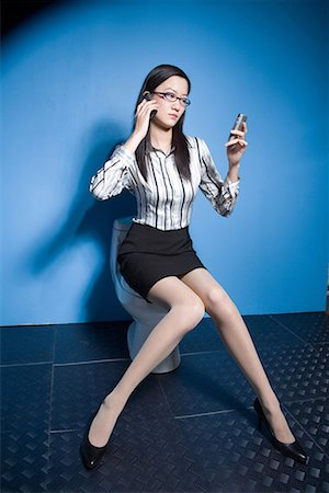 a business woman phoning Stock Photo - Premium Royalty-Free, Code: 642-02005997