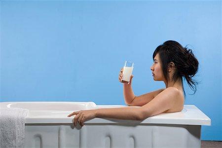 a bathing woman taking milk Stock Photo - Premium Royalty-Free, Code: 642-02005992