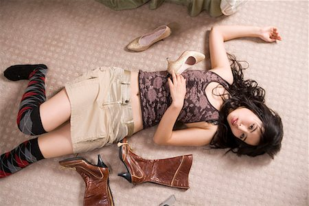 a fashionable woman lying on the floor Stock Photo - Premium Royalty-Free, Code: 642-02006613