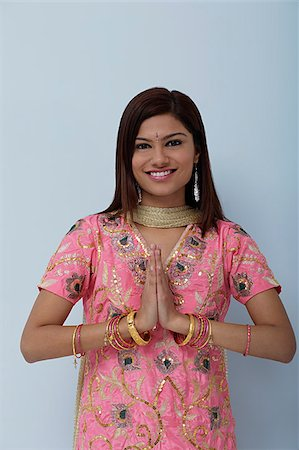 singapore traditional costume lady - Young woman dressed in traditional Indian clothing (salwar kameez) Stock Photo - Premium Royalty-Free, Code: 655-02375793