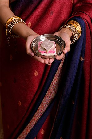 singapore traditional costume lady - Indian woman offering sweets Stock Photo - Premium Royalty-Free, Code: 655-02375849