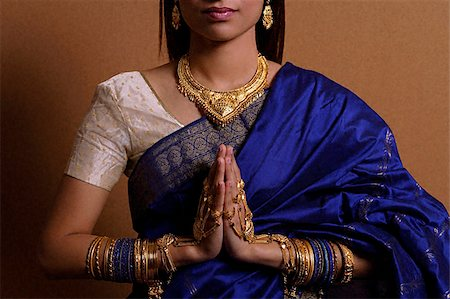 singapore traditional costume lady - Indian woman with hands held in prayer position Stock Photo - Premium Royalty-Free, Code: 655-02375858