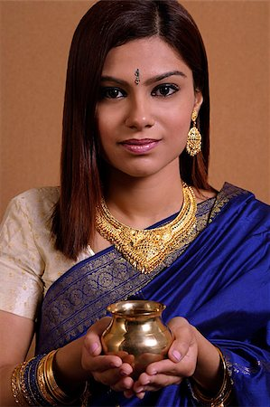Indian woman holding offering Stock Photo - Premium Royalty-Free, Code: 655-02375885