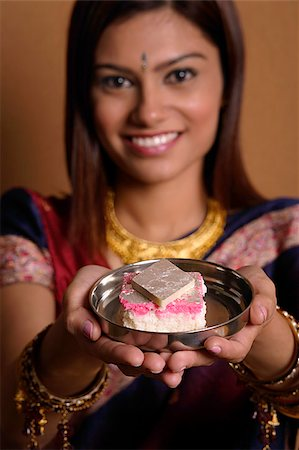 singapore traditional costume lady - Indian woman offering plate of sweets Stock Photo - Premium Royalty-Free, Code: 655-02375889