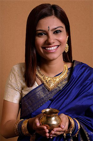 singapore traditional costume lady - Indian woman holding offering Stock Photo - Premium Royalty-Free, Code: 655-02375881