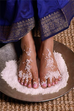 singapore traditional costume lady - Indian woman with feet in salt scrub Stock Photo - Premium Royalty-Free, Code: 655-02375899