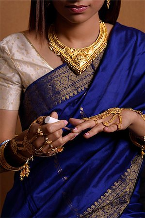 singapore traditional costume lady - Indian woman painting her nails Stock Photo - Premium Royalty-Free, Code: 655-02375900