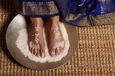 singapore traditional costume lady - Indian woman's feet in salt scrub Stock Photo - Premium Royalty-Free, Code: 655-02375903