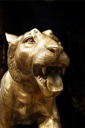 Closeup of bronze tiger head in Little India,Singapore Stock Photo - Premium Royalty-Free, Code: 655-03082786