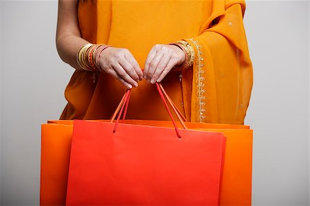 singapore traditional costume lady - crop shot of woman in sari holding shopping bags Stock Photo - Premium Royalty-Free, Code: 655-03082796